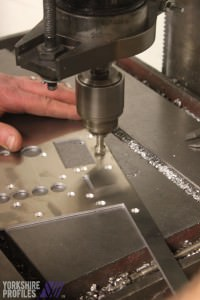 The countersinking of metal panels